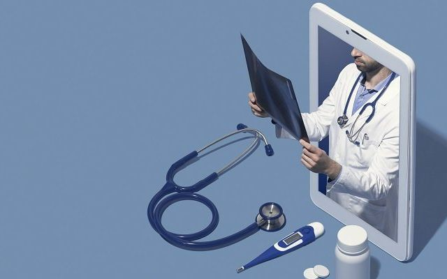 Professional,Doctor,In,A,Smartphone,Giving,A,Consultation,Online,And